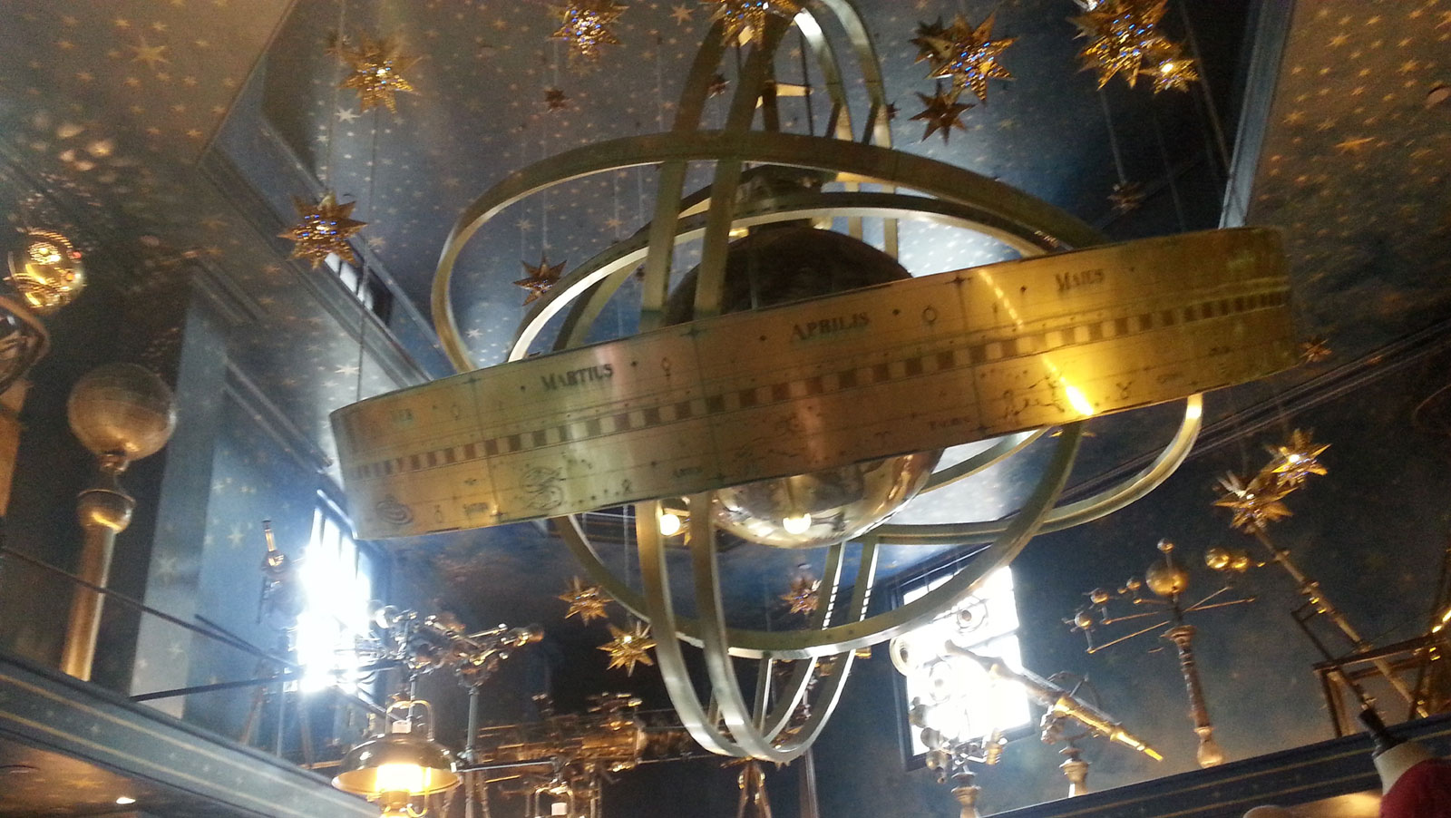 Orreries, globes, and telescopes on display in the Wiseacre's Wizarding Equipment store in Diagon Alley, December 2015.