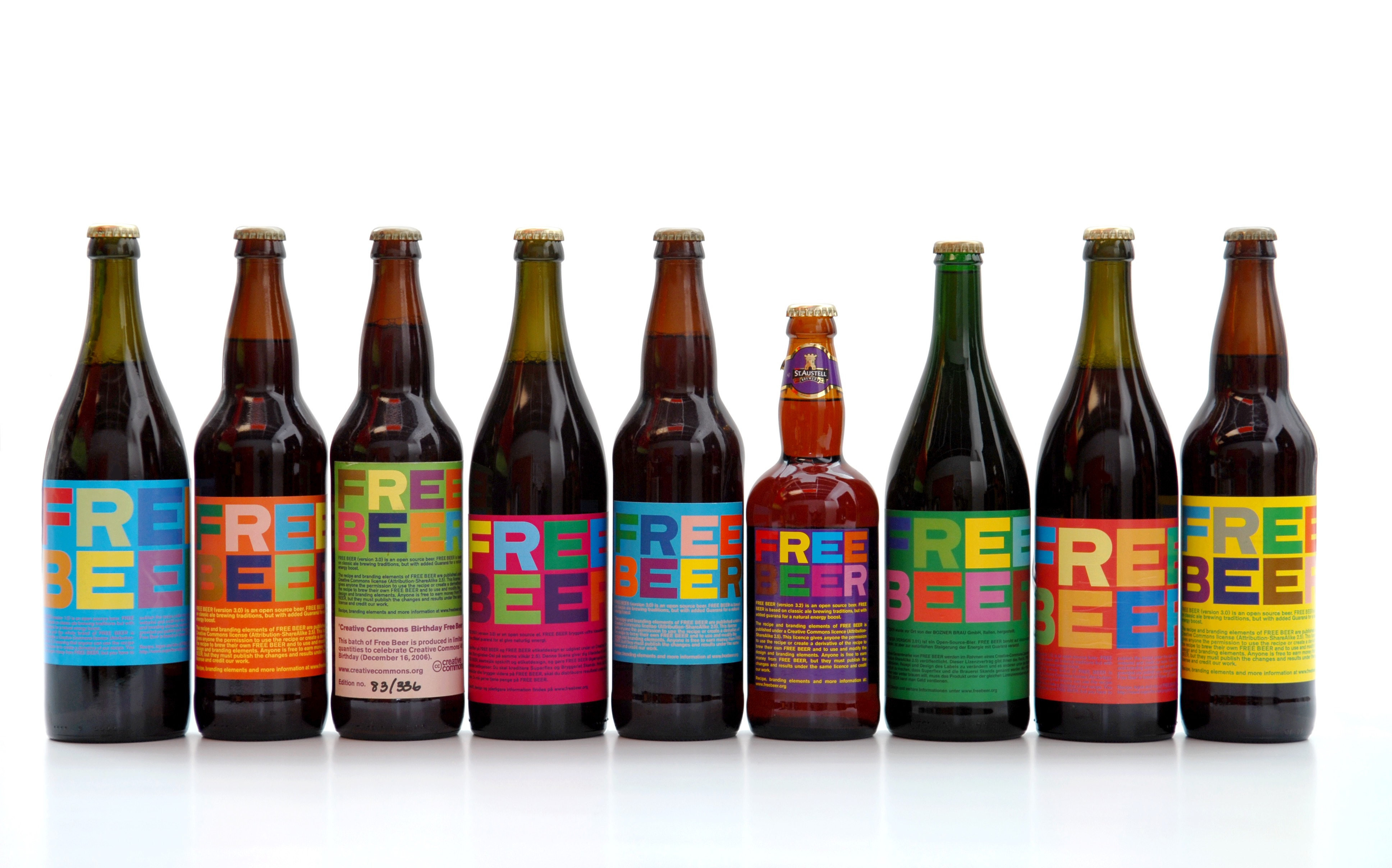 Photograph of nine different varieties of free beer, each bearing a label similar to that in figure 1.