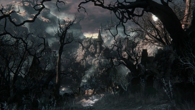 Color image of a castle, seen from a distance through gnarled, foreboding trees, under a dark, cloudy night sky.