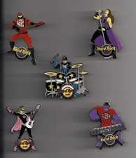 Five pins in five different shapes: bass player, lead singer, drummer, guitar player, keyboard player.