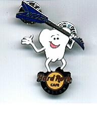 Pin in the shape of a tooth with a happy face holding a guitar over its shoulder.