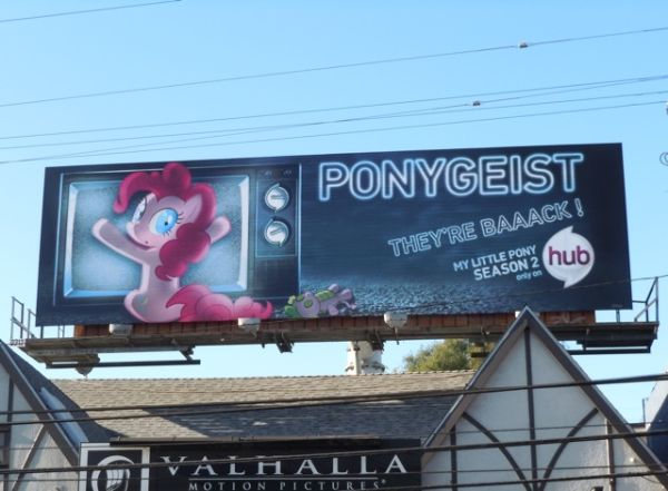 Billboard with a pony pressed up against a television in a parody of Poltergeist, reading: Ponygeist. They're Baaack! My Little Pony Season 2 only on hub.
