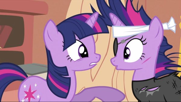 Two ponies face to face, one with torn clothing and an eye patch.