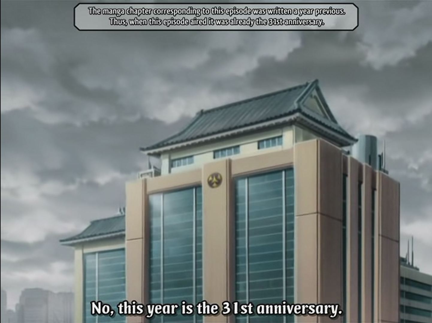 Screen cap of exterior of building. Supertitle: 'The manga chapter corresponding to this episode was written a year previous. Thus, when this episode aired it was already the 31st anniversary.' Subtitle: 'No, this year is the 31st anniversary.'