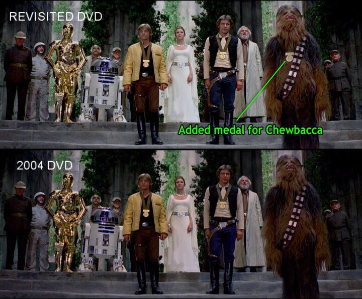 Split-screen image comparing two shots with Luke Skywalker, Han Solo, and Chewbacca standing before Princess Leia. Top image labeled REVISITED DVD. Bottom image labeled 2004 DVD. Chewbacca's medal indicated in top image (and not present in bottom image) with the following text: 'Added medal for Chewbacca.'