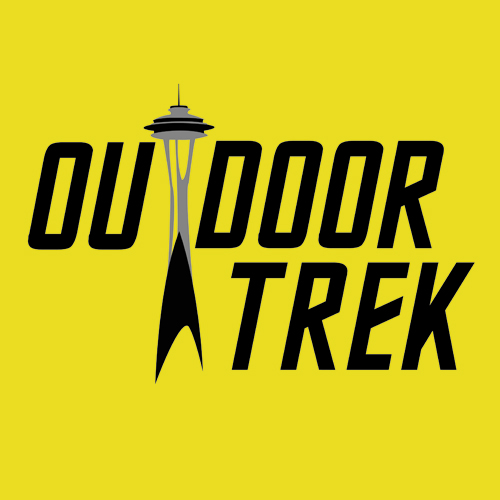 Square yellow block with all-caps OUTDOOR TREK in the Star Trek font, with the T of 'outdoor' being a drawing of the Seattle Space Needle.