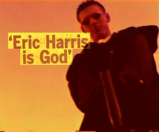 Photo of Eric looking down at the camera with the caption 'Eric Harris is God'.