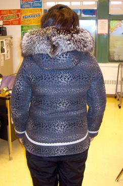 Back of a parka with leopard print.