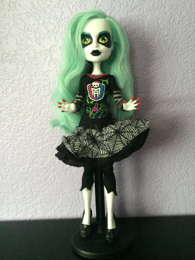 Spectra Repaint as Beetlejuice. Doll painted with bright red fingernails, light green hair, and black T-Shirt and spiderweb skirt.