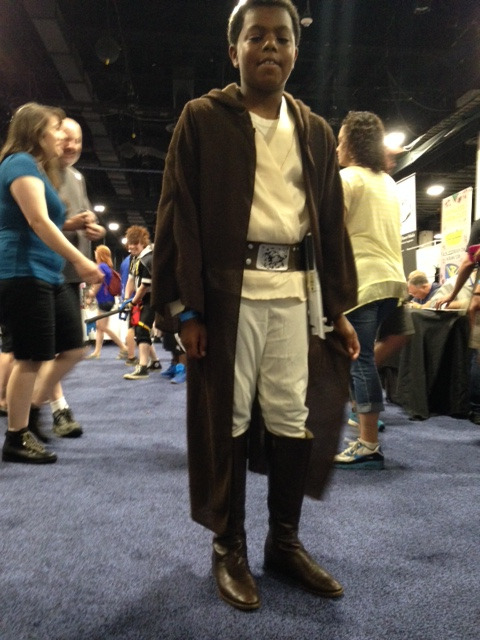 Cosplayer dressed as Mace Windu from Star Wars