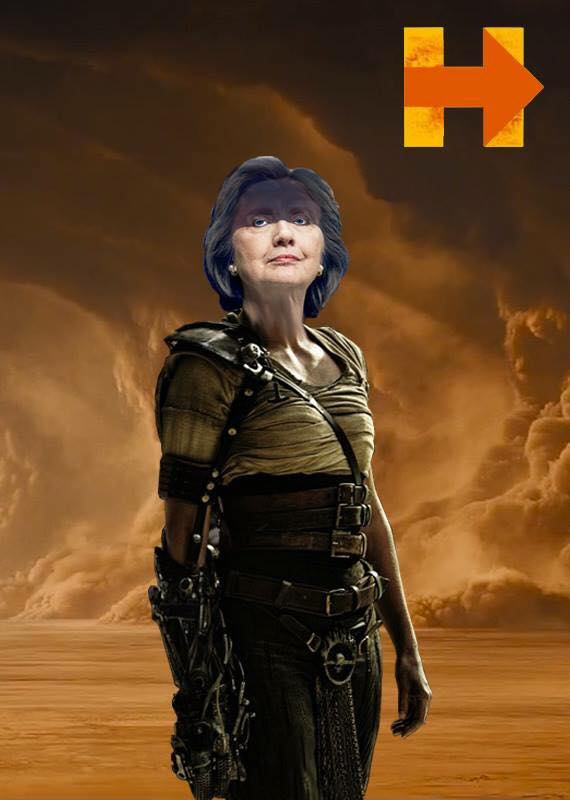 A Photoshopped piece of fanart depicting Hillary Clinton, grey-haired, as Furiosa from Mad Max Fury Road. Hillary stands against a desert backdrop with rolling clouds of dust, looking upwards; she is wearing a cream, brown and black outfit with a number of belts around her waist, and a mechanical prosthetic forearm strapped to one of her arms. In the top right corner is the Hillary Clinton campaign logo, with an orange arrow and the rest of the logo yellow.