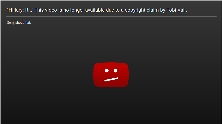 A screenshot of an error message for a YouTube video, showing the YouTube logo with a regretful face formed from a colon and a forward slash against a black background. The message at the top reads: Hillary: R... This video is no longer available due to a copyright claim by Tobi Vail. Sorry about that.